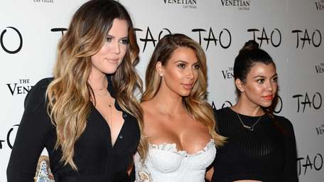 Khloe Kardashian, left, Kim Kardashian and Kourtney Kardashian