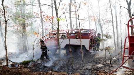 Firefighters from Nassau and Suffolk Counties battle a