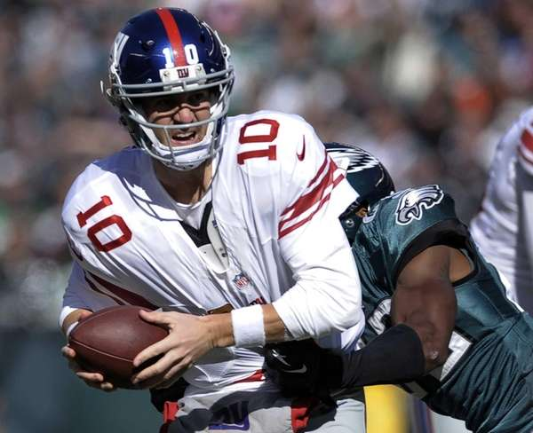 Eli Manning is hit by the Philadelphia Eagles'