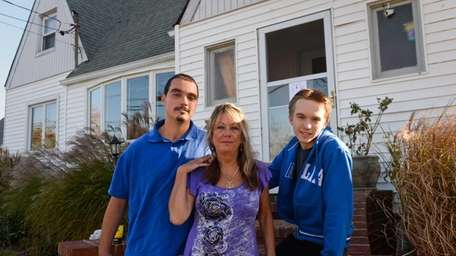 Donna Schwarz stands with her sons Eric, left,