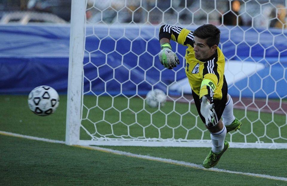 John Glenn goalkeeper Max Karen dives for the