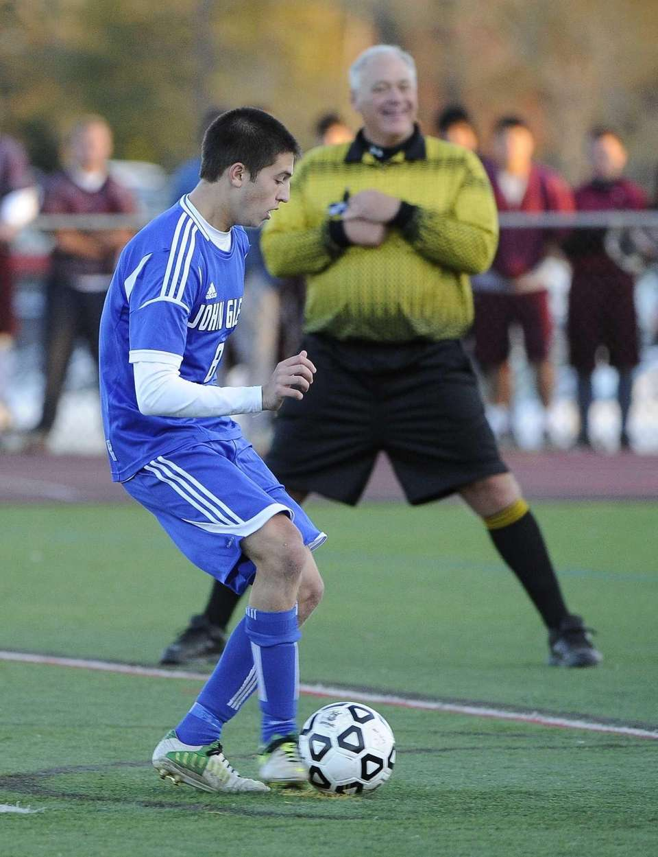 John Glenn's Andrew Pick kicks the game-winning penalty