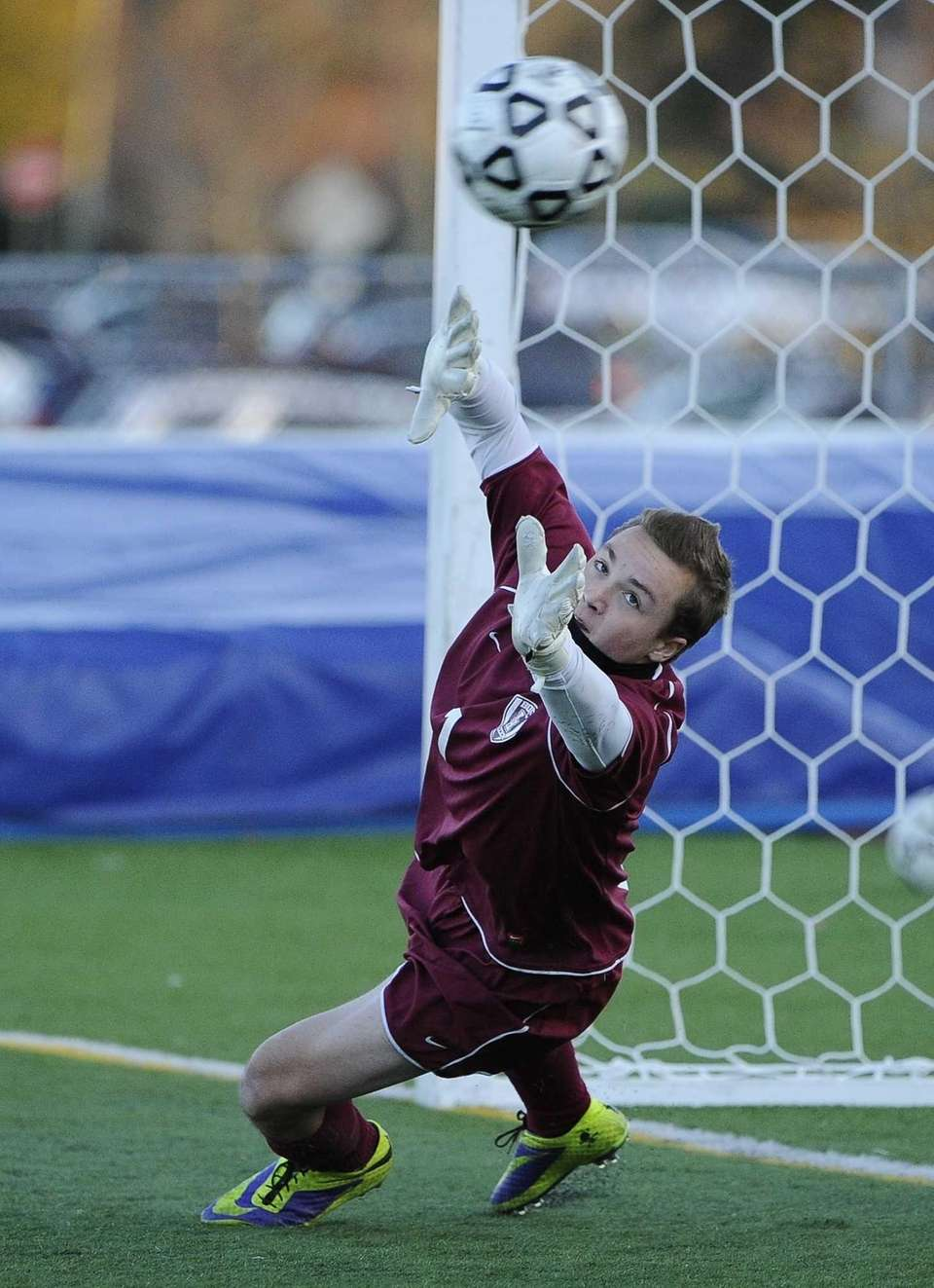 East Hampton goalkeeper Nick Tulp reaches for the