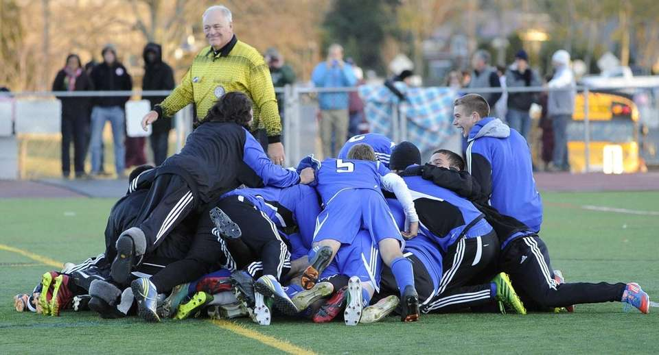 John Glenn teammates pile on goalkeeper Max Karen