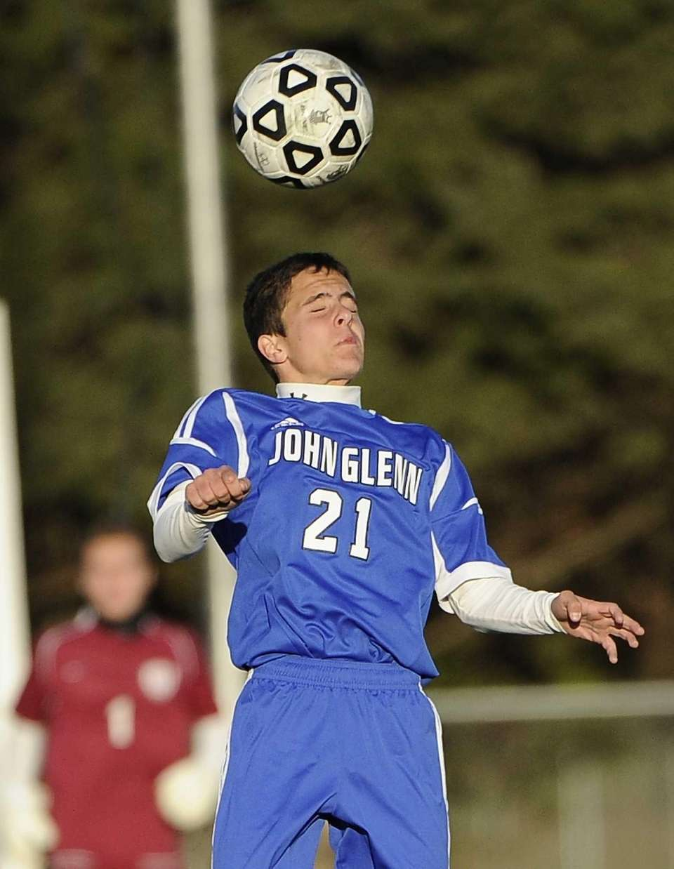 John Glenn's Jonathan Schefer heads the ball against