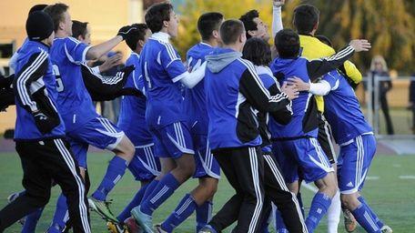 John Glenn teammates celebrate their win over East