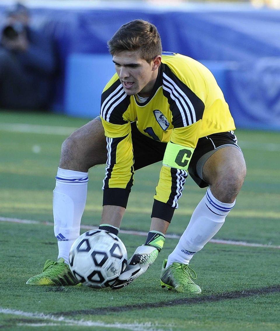 John Glenn goalkeeper Max Karen makes a save