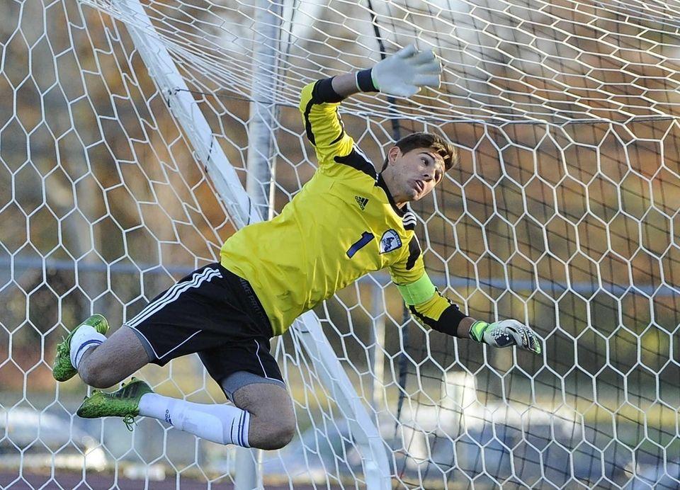 John Glenn's goalkeeper flies in the net after