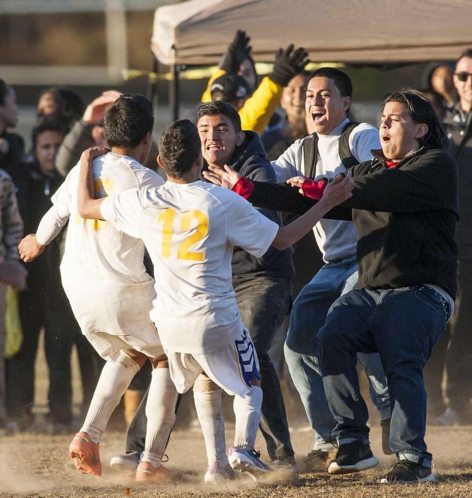 Central Islip's Misael Rosa, left, along with teammate