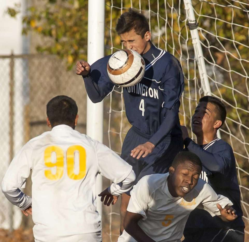 Huntington's Alex Castillo goes up for a header