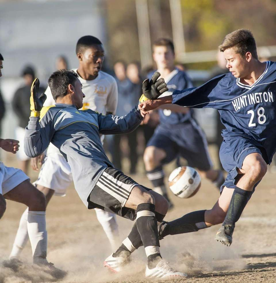 Central Islip goalkeeper Rene Melgar, left, makes the