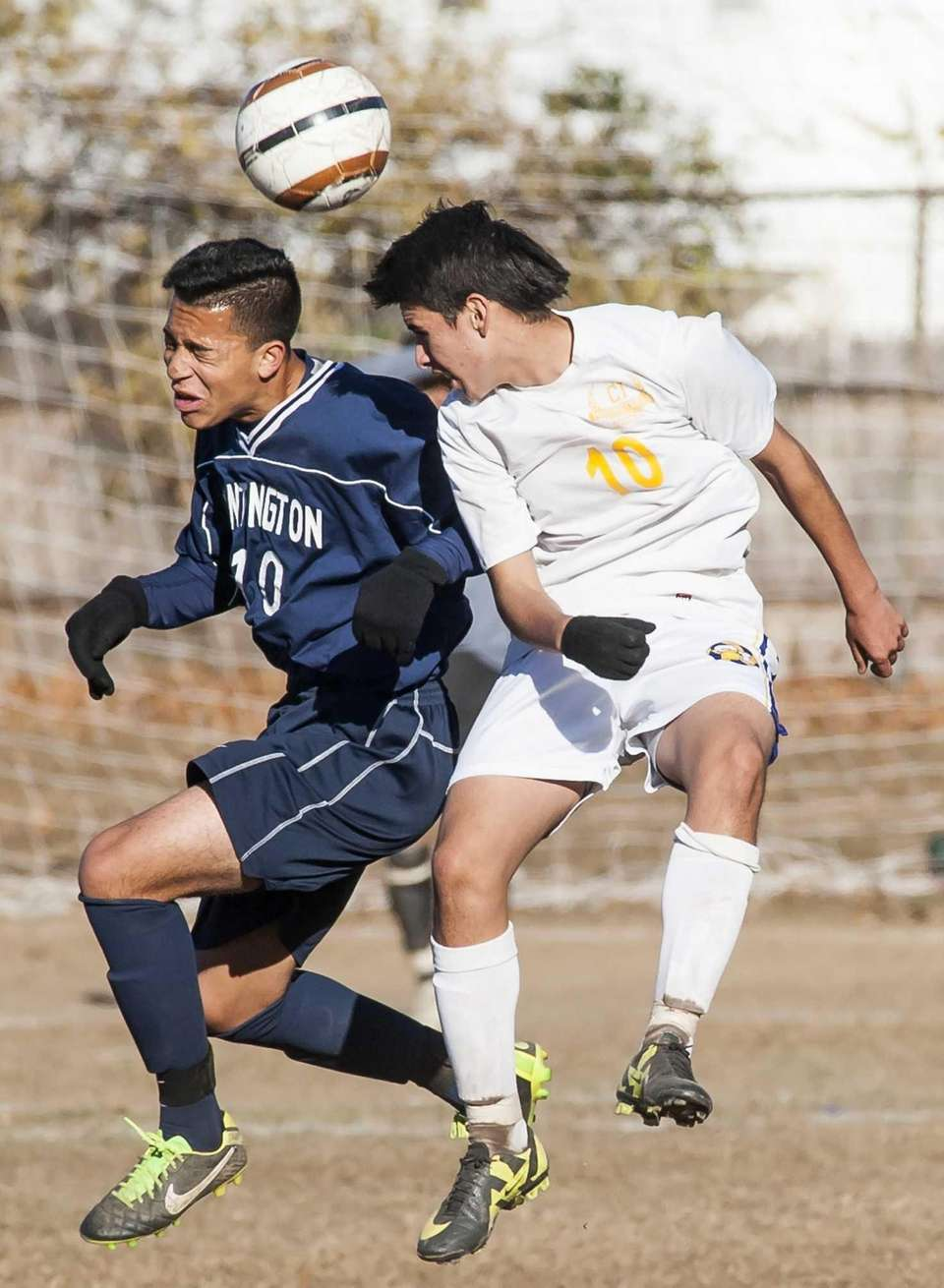 Central Islip's Marcos Melgar, right, goes up for