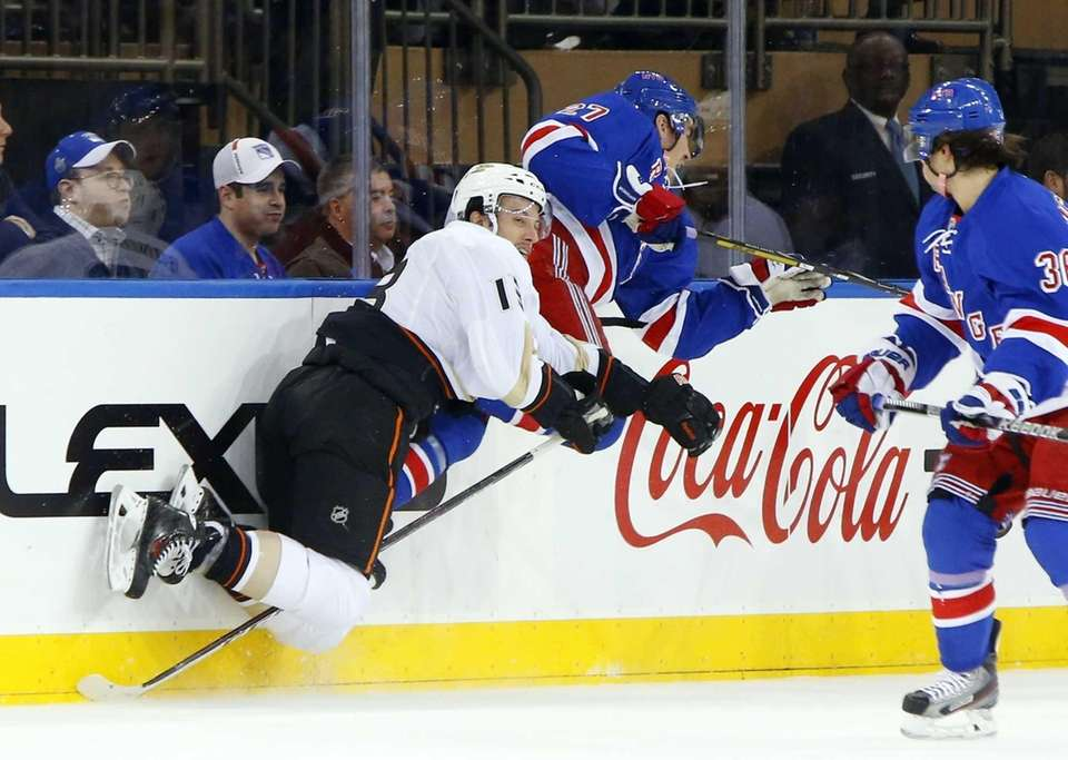 The Anaheim Ducks' Nick Bonino collides with Ryan