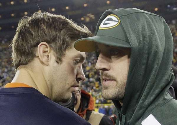 Green Bay Packers quarterback Aaron Rodgers, right, talks