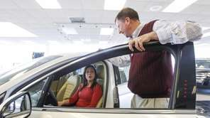 Thomas Hart, sales consultant at Riverhead Ford-Lincoln shows