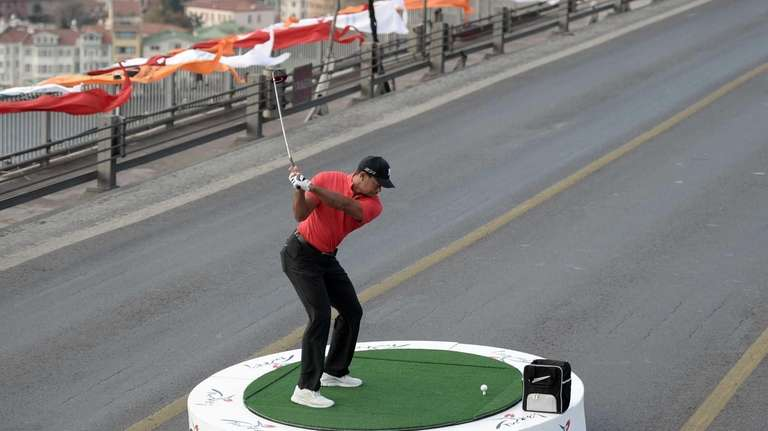 Tiger Woods takes a shot on the iconic