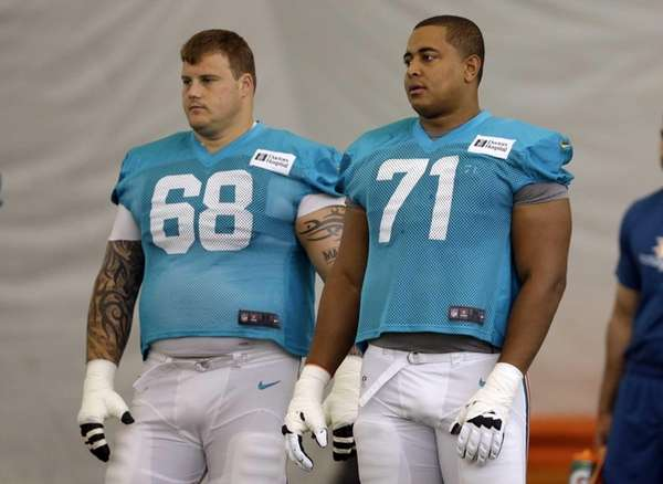 Miami Dolphins guard Richie Incognito, left, and tackle