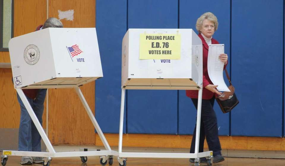 Voters cast their ballots at Elwood Middle School