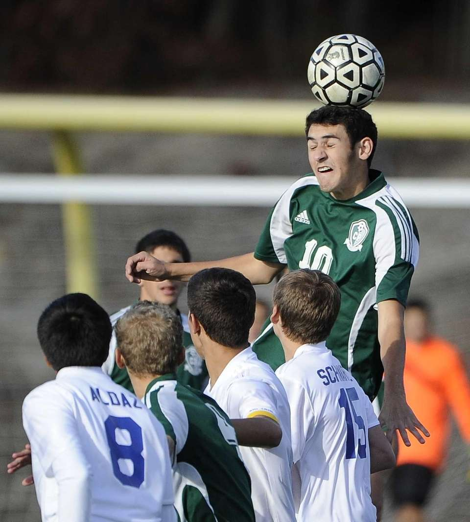 Carle Place's Billy Chiappone heads the ball against