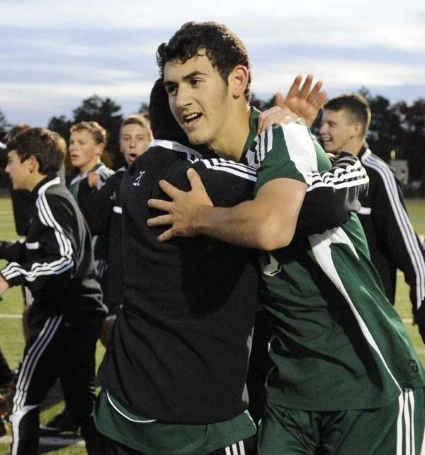 Carle Place's Billy Chiappone, facing, is congratulated by