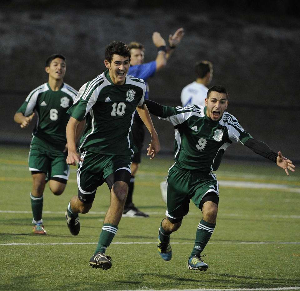 Carle Place's Billy Chiappone, center, celebrates his winning