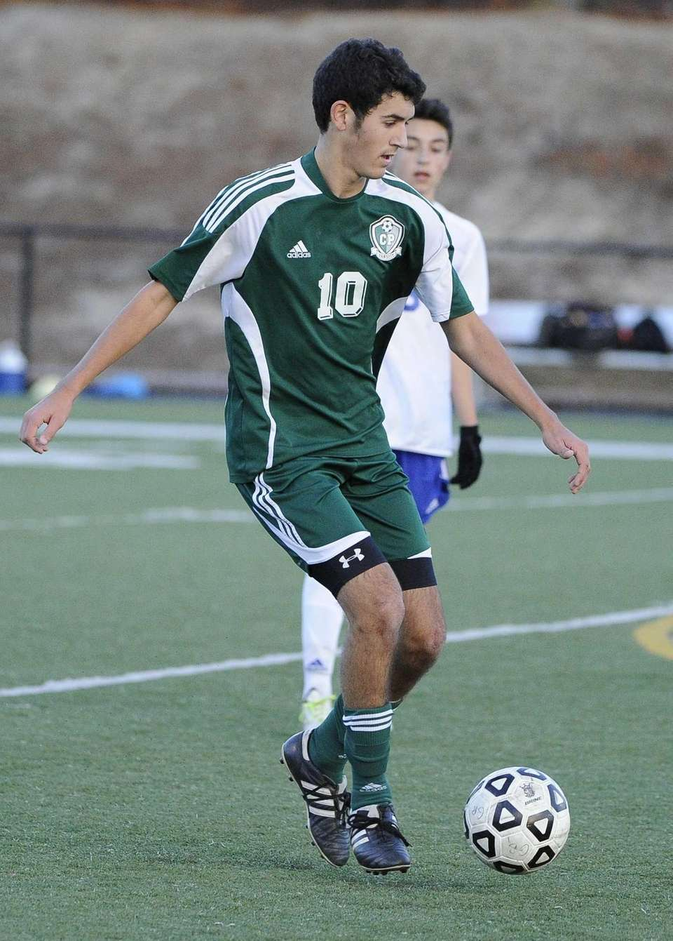 Carle Place's Billy Chiappone controls the ball against