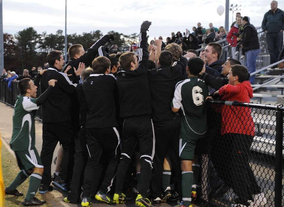 Carle Place teammates celebrate with fans after their