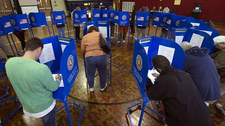 Voters cast ballots at the Lindell Elementary School