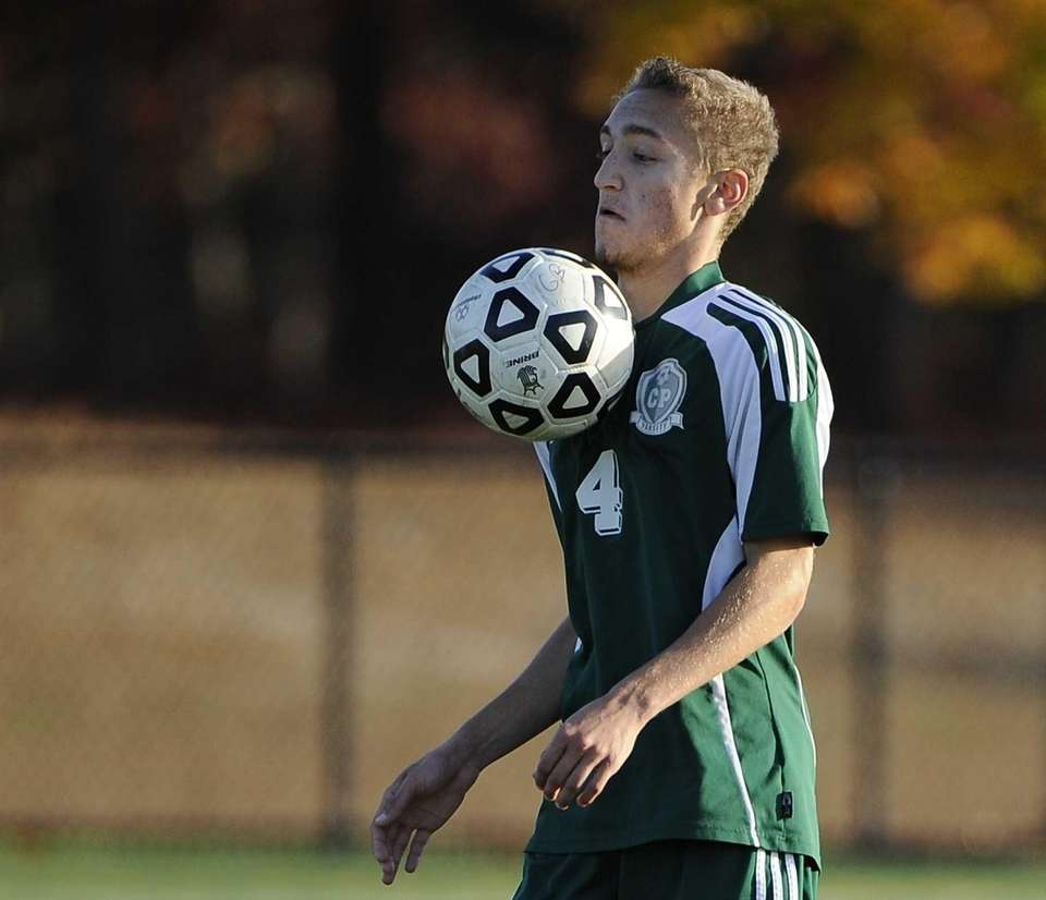 Carle Place's Dylan Klein traps the ball against