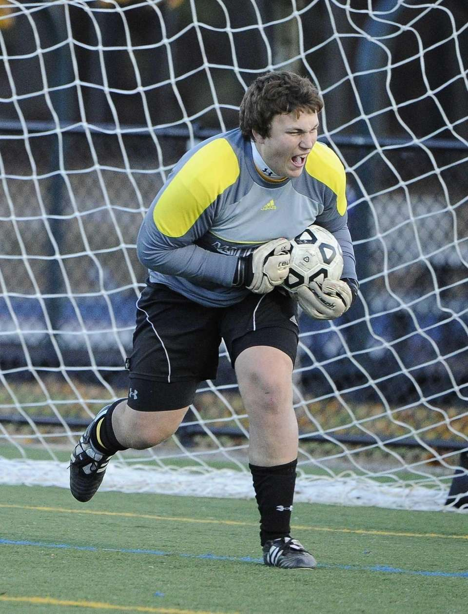 Mattituck goalkeeper Stephen Ostrowski makes a save against