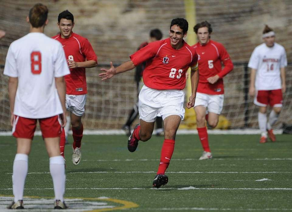 Friends Academy's Jon Nierenberg, center, reacts after scoring