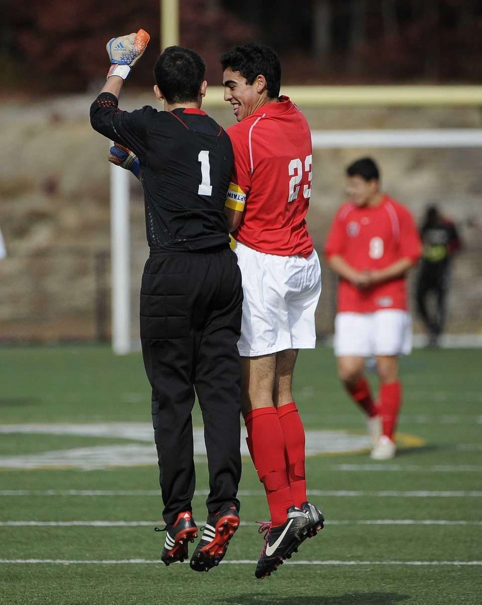Friends Academy's Jon Nierenberg, right, celebrates his second