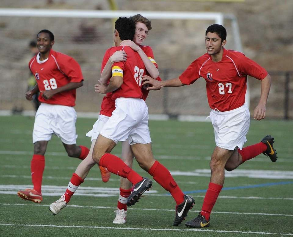 Friends Academy's Jon Nierenberg (23) is congratulated by