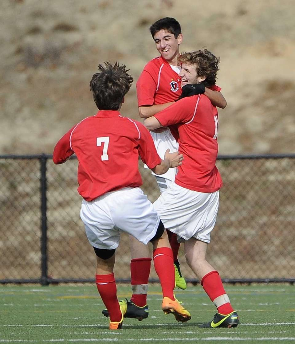Friends Academy's Oliver Muran, center, celebrates his goal