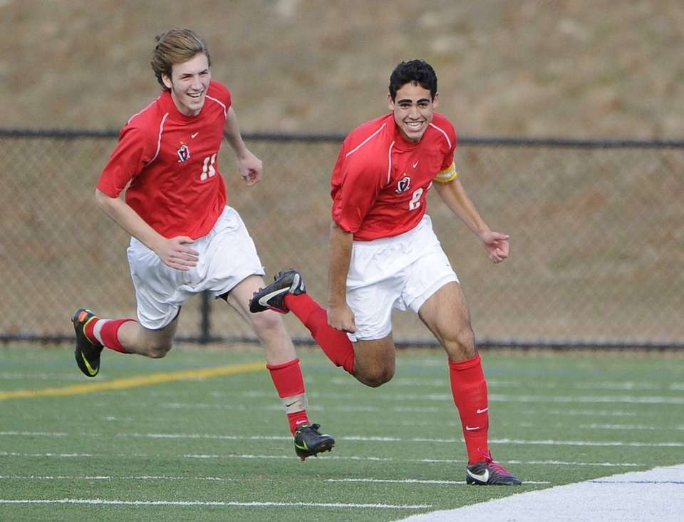Friends Academy's Jon Nierenberg, right, reacts after scoring
