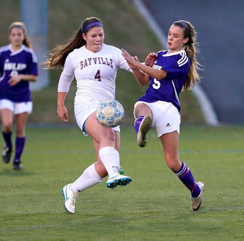 Sayville's Erin Lankowicz clears the ball from Islip's