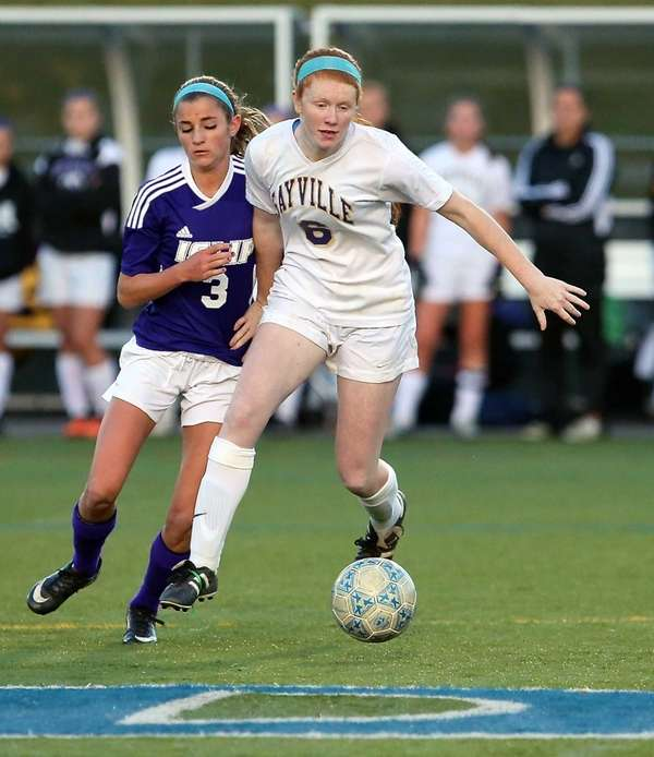Sayville's Julianne Johnston moves the ball past Islip's