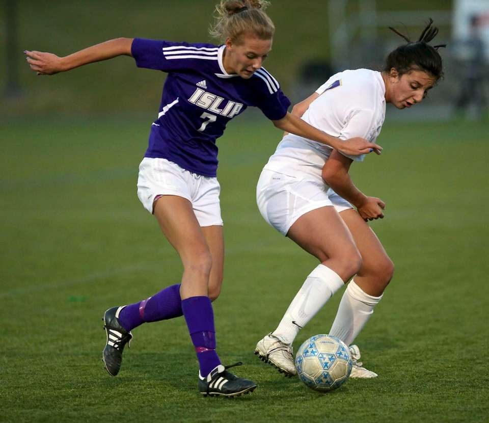 Islip's Lyndsey Sparks, left, looks to take the