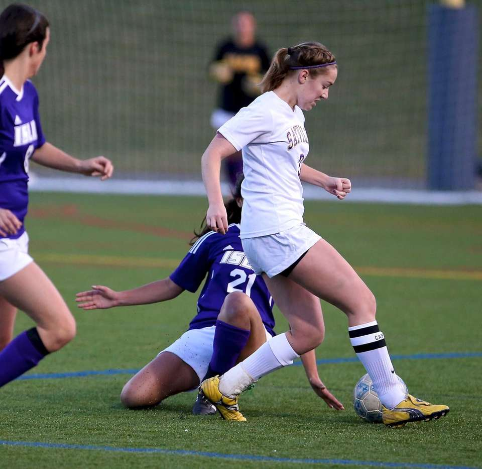 Sayville's Michelle Civitella dribbles past the Islip defender