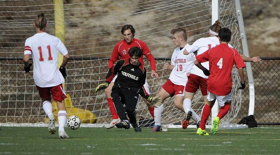 Friends Academy's Oliver Muran scores on Southold goalkeeper