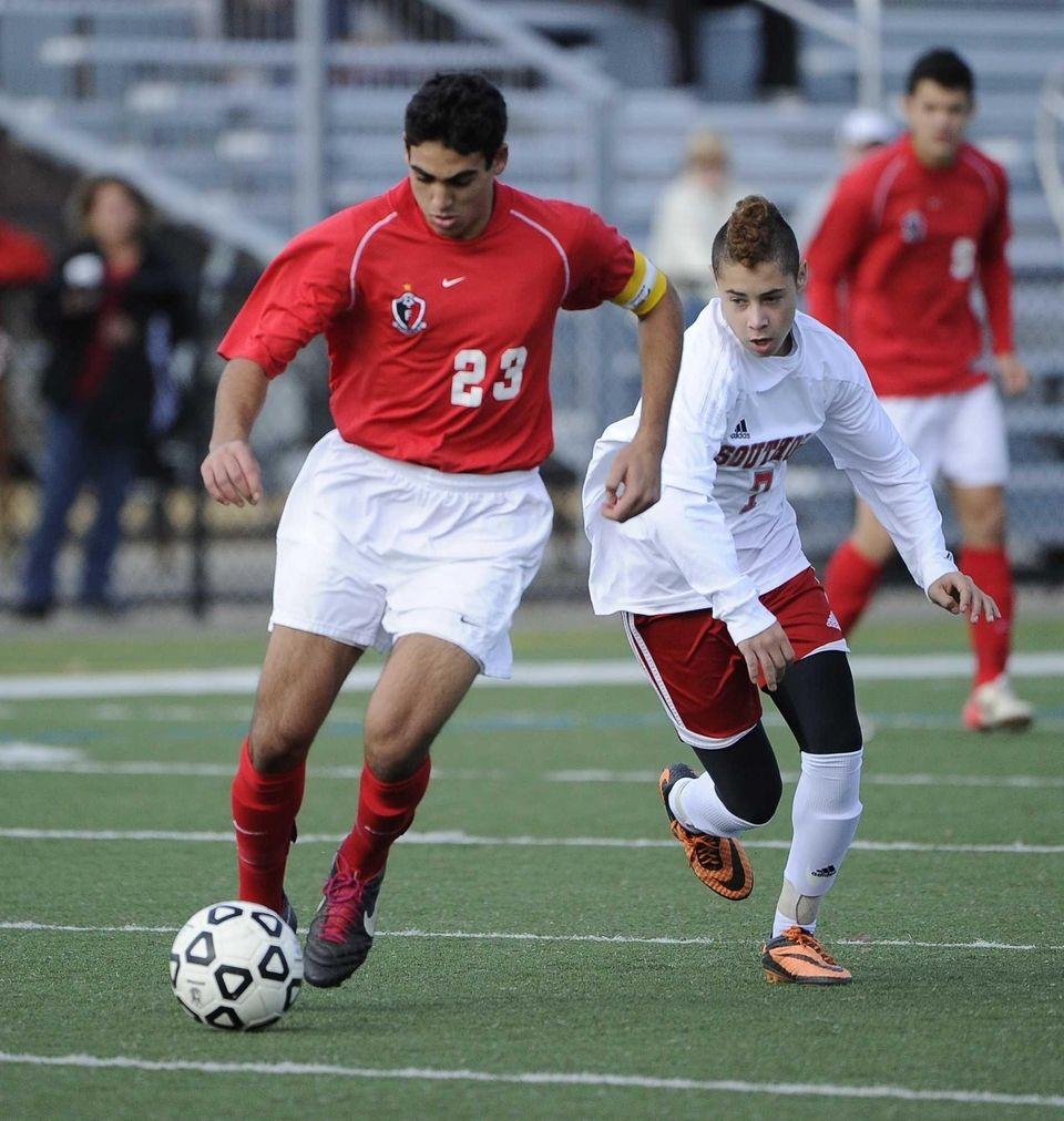 Friends Academy's Jon Nierenberg controls the ball ahead