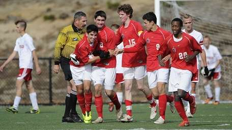 Friends Academy's Oliver Muran, third from left, celebrates