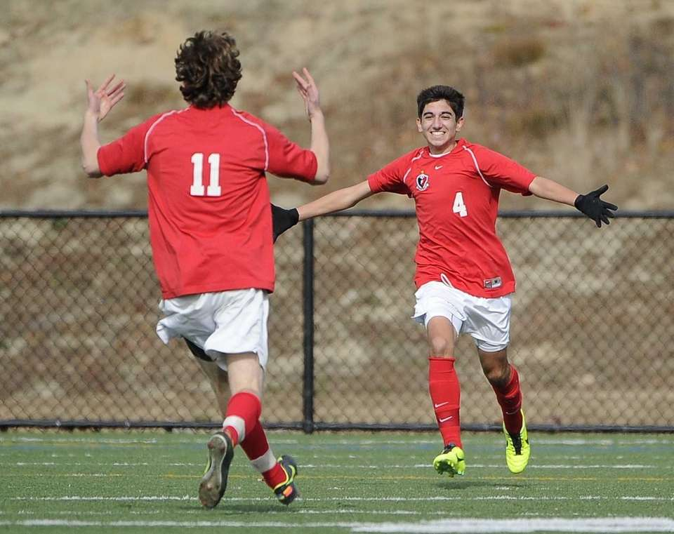 Friends Academy's Oliver Muran, facing, celebrates his goal