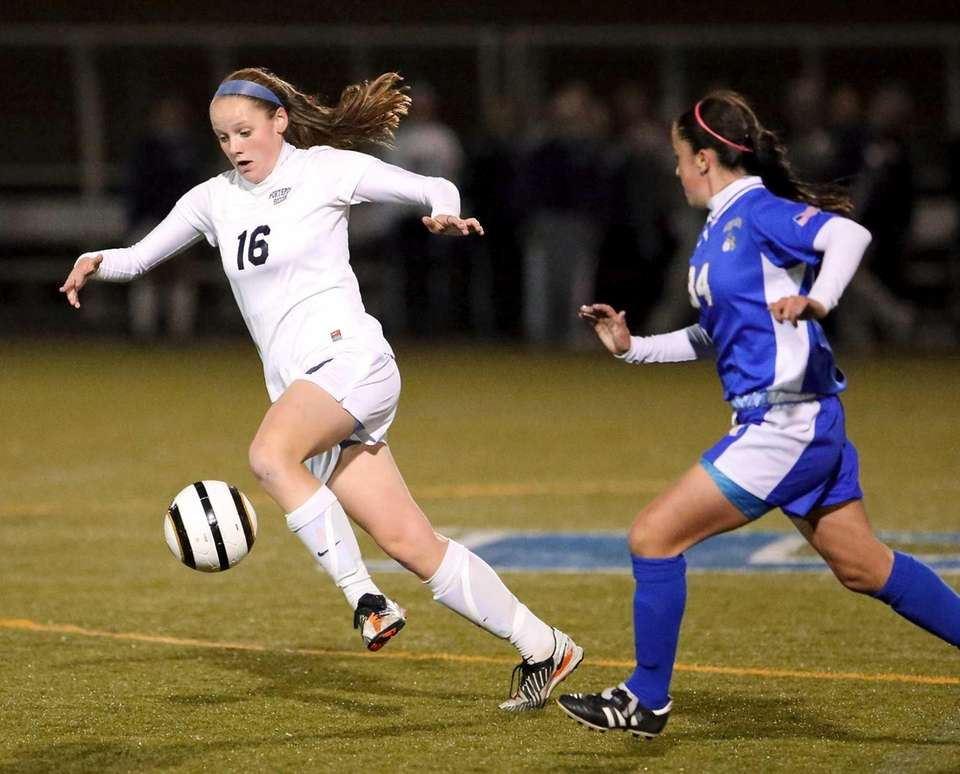Northport's Emily Robarge takes the ball into the