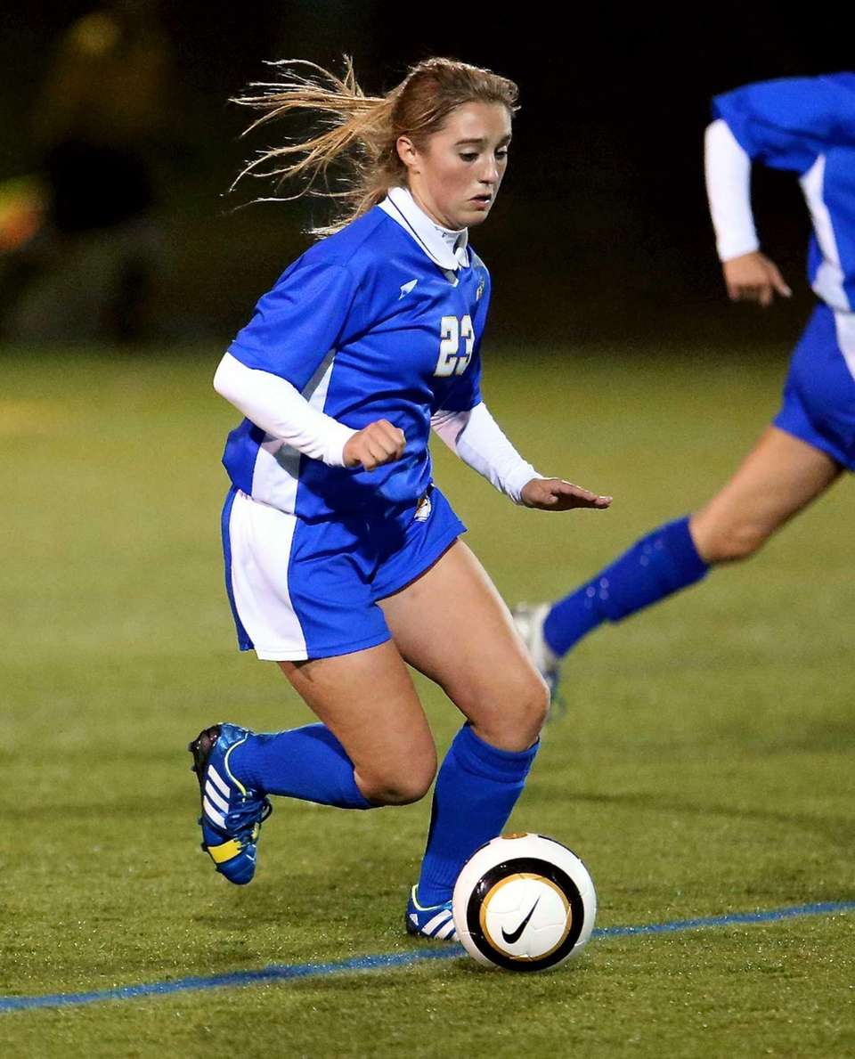 West Islip's Carly Kohler moves the ball through