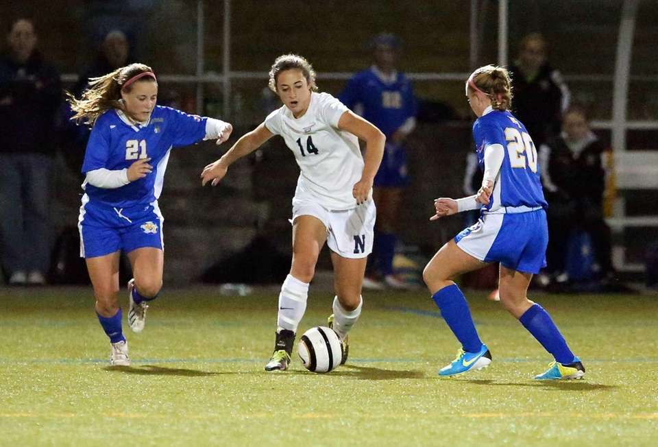 Northport's Vincenza Petrone moves the ball between two