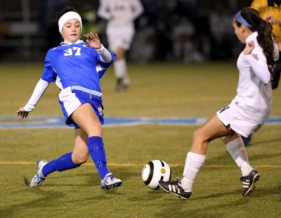 West Islip's Jessica Bendetti looks to clear the