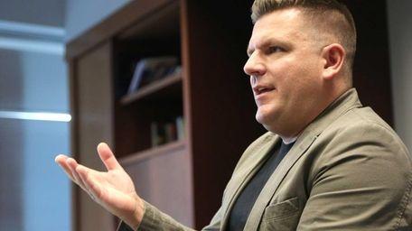Center Moriches teacher Matthew Craig Charvat talks to