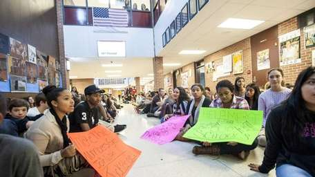 Students sit in the front hallway at Southampton