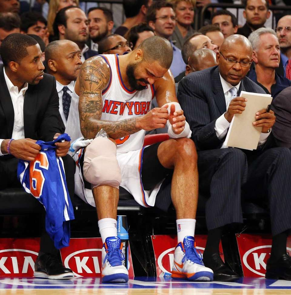 Tyson Chandler sits on the bench after suffering